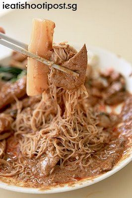 """""""Satay Bee Hoon -  Redhill Food Centre, Singapore"""". Cooked with vermicelli, kangkong (water spinach), cuttlefish, satay sauce, pig's liver, some lean slices of pork."""