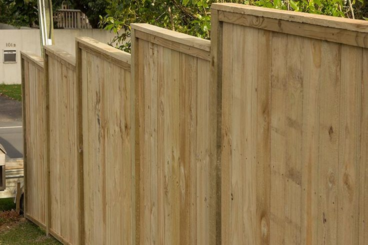 Top stepped with cap wooden fence.