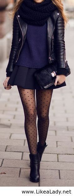 Leather jacket, sweater, skirt, tights and boots.