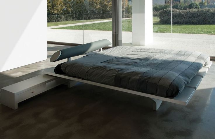 A low profile bed with a unique bed frame & upholstered headend in lots of colours & finishes