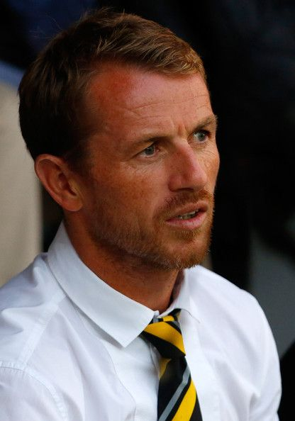Gary Rowett Photos Photos - Manager Gary Rowett of Burton Albion watches on during the Capital One Cup Second Round match between Burton Albion and Fulham at the Pirelli Stadium on August 27, 2013 in Burton-Upon-Trent, England - Burton Albion v Fulham