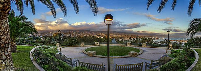 Panoramic view of Santa Barbara from Santa Barbara City College. On the right you can see the Santa Barbara Harbor and Stearns Wharf. All the way on the left peeking out from under the fronds is the Santa Barbara Courthouse Clock Tower.