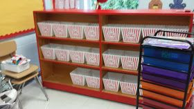use popcorn buckets from the dollar store for book baskets. Love this for a Hollywood themed classroom!