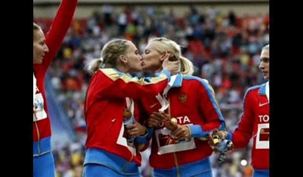 Kseniya Ryzhova and Tatyana Firova were two of the Russian team who won the 4x400m relay in Moscow over the weekend. When on the podium receiving their medals, they kissed, as seen in this photo. It is being taken in Russia as a protest against the anti-gay laws and has kicked up quite a fuss. Good for them. They have the courage of their convictions.  Take a look at the expressions on their teammates' faces. I think it's important to point out that if this is in fact a protest then these...