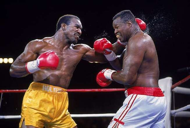 June 19, 1992: Evander Holyfield defeated Larry Holmes by UD and retained the World heavyweight title                                                                                                                                                                                 More