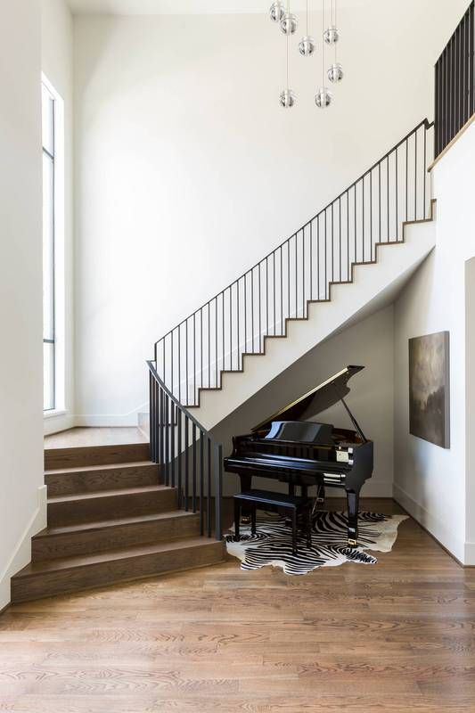 floating staircase + stunning piano.