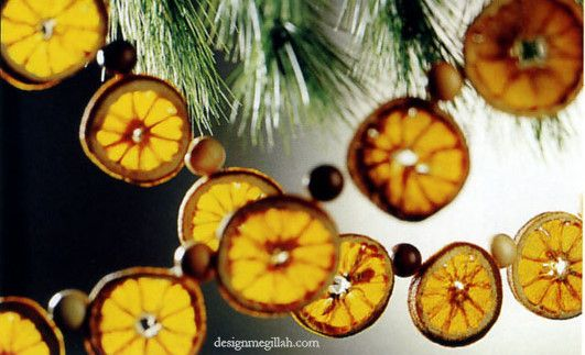 """These oranges were sliced and baked in a 275 degree oven for about two hours or until dry, then sprayed with a clear varnish. String with a thread and needle, alternating with wooden beads in colors or natural wood tones. Apples or lemons would work, too."" from designmegillah.com"