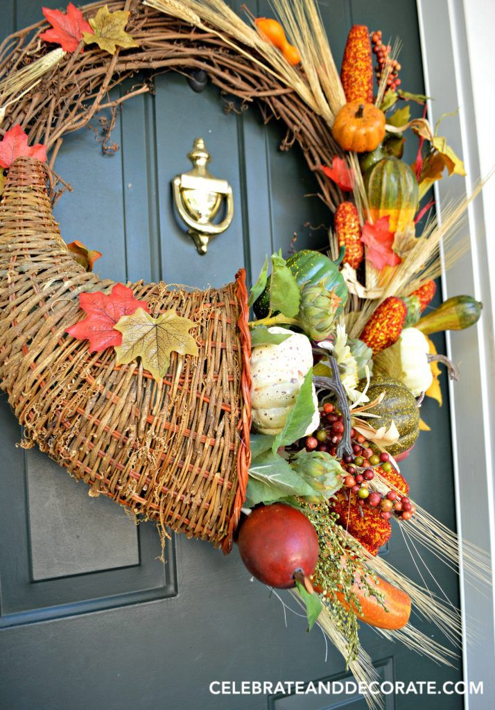 Cornucopia or horn of plenty wreath ready to greet guests for Thanksgiving or throughout the Fall.  This is actually an easy DIY, full tutorial here!