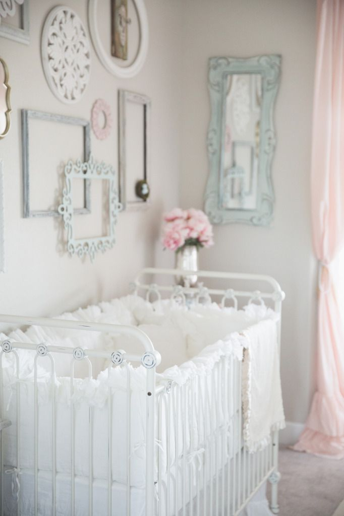 Sweet nursery ❤. Loving the colors and picture frames on the wall!