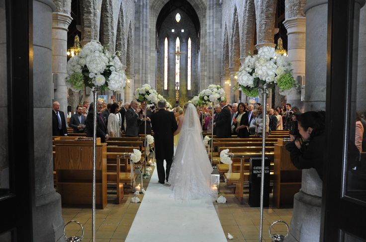 An Aisle Runner and Green and White Floral Displays really help make an entrance. Visit www.gotchacovered.ie