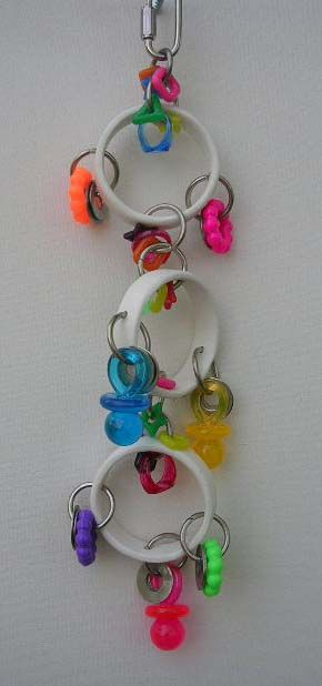 PVC Tambourine from TNT Bird Toys - PVC rings (or large bagels); drill holes and attach plastics and washers with O-rings