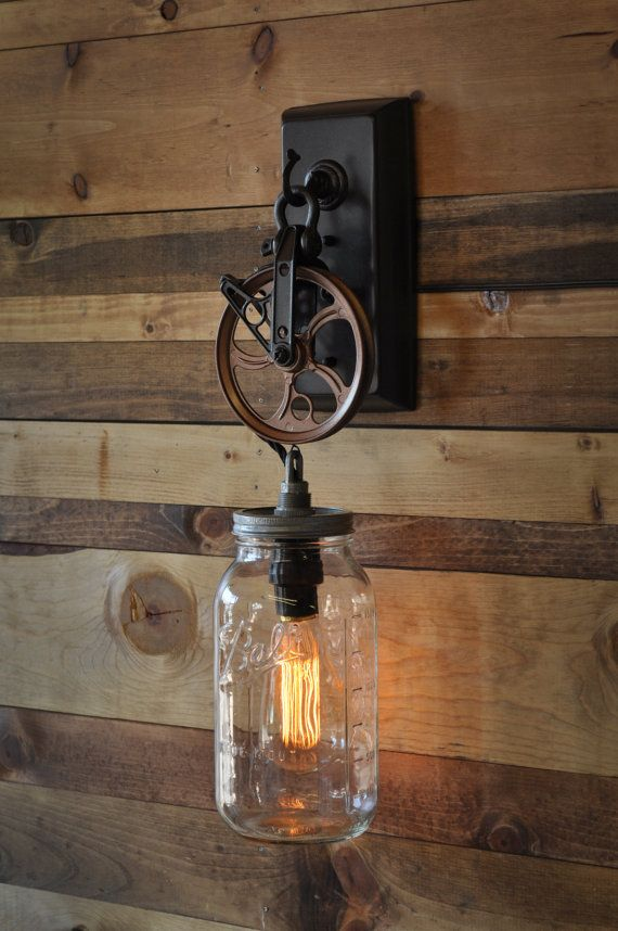 This is a wall sconce fashioned from a canning jar / mason jar. I have many sizes of jars, including two sizes in the teal glass. The pulley is
