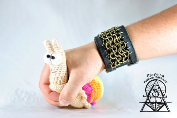 Leather bracelet with a brass chainmail.