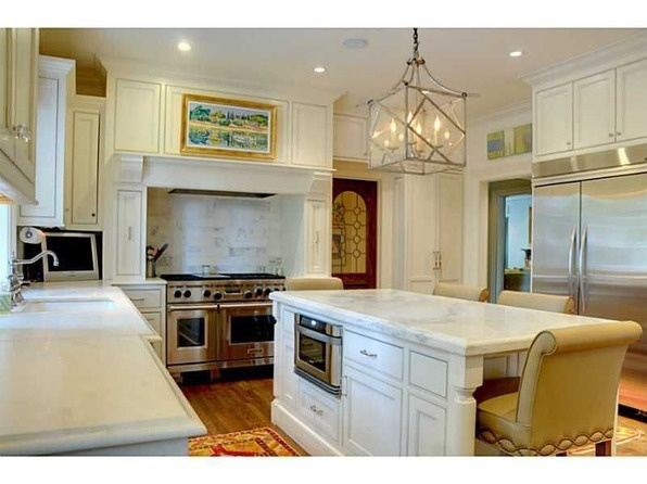 Fabulous Mediterranean home renovated and expanded by Stan Dixon. Gourmet kitchen with marble counters, top of line appliances, walk-in pantry. Formal living room with fireplace opens to office and breakfast room. Large dining room. Family room off the back of the house features fireplace and built-in entertainment shelving. #zillow