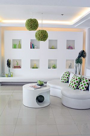 The Living Area Holds A White Custom Made Couch And Coffee Table Set Where