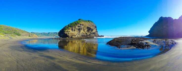 Te Henga (Bethells Beach) north-west of Auckland City, where the mouth of the Waitakere River flows into the Tasman Sea. North Island, New Zealand.