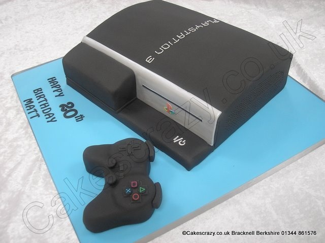 PS3 Cake. Playstation 3 base unit and controller novelty cake. The cake is shaped to resemble this popular games console and is complimented with a matching ps3 controller made of cake