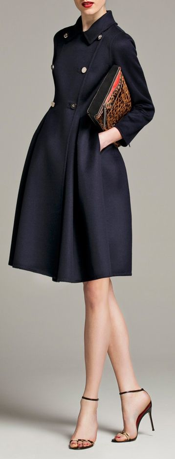 Carolina Herrera. Lovely coat. Feels like an image we'd see from the 50s. Navy isn't a colour to stress over too much. It adapts well to skin tones and the other elements of the apparel. This could be fine on any of the 5 Autumn-influenced types of colouring.