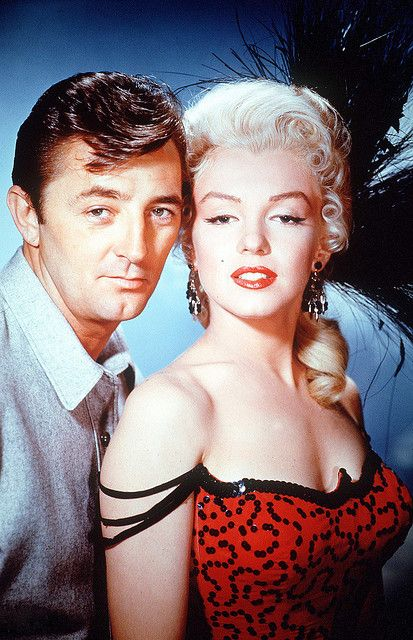 "Marilyn Monroe and Robert Mitchum 1954 ""The River of No Return"" (I am pinning under Beauties only because Marilyn is the ONLY one prettier than Robert Mitchum)."