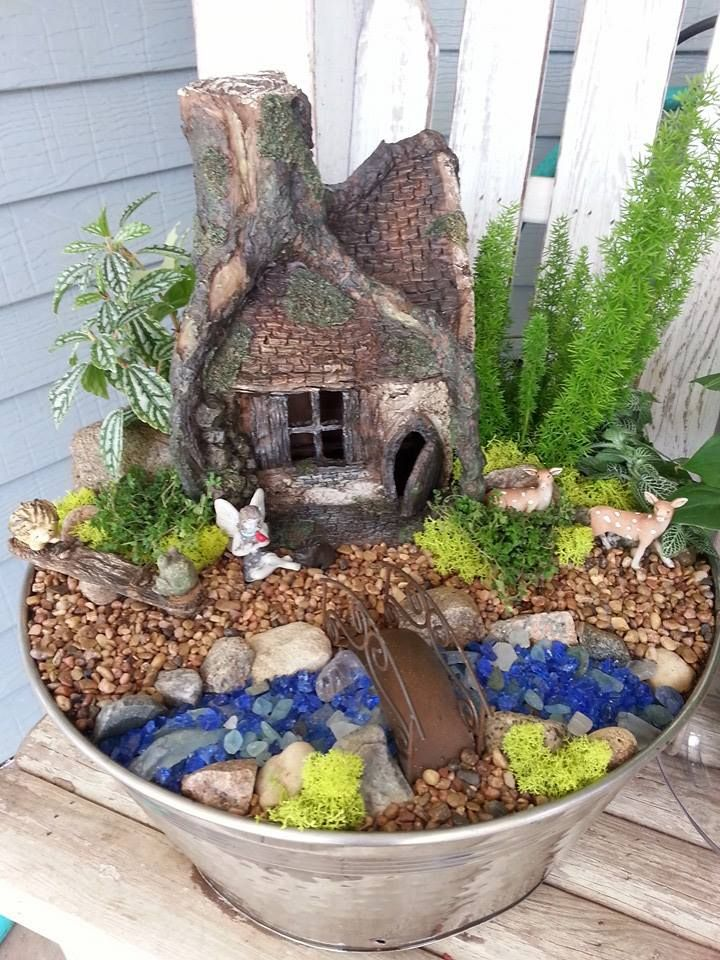 This treehouse inspired fairy house adds beauty