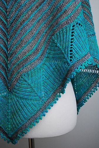 Leventry is a sophisticated shawl worked in two colors of fingering weight yarn. Starting with a garter tab, the shawl is worked from the top down and begins with two-color stripes that combine the textures of stockinette and garter stitch. The lower portion is highlighted by a band of geometric lace, and the border is finished with an additional stripe of color and a lacy picot bind off.