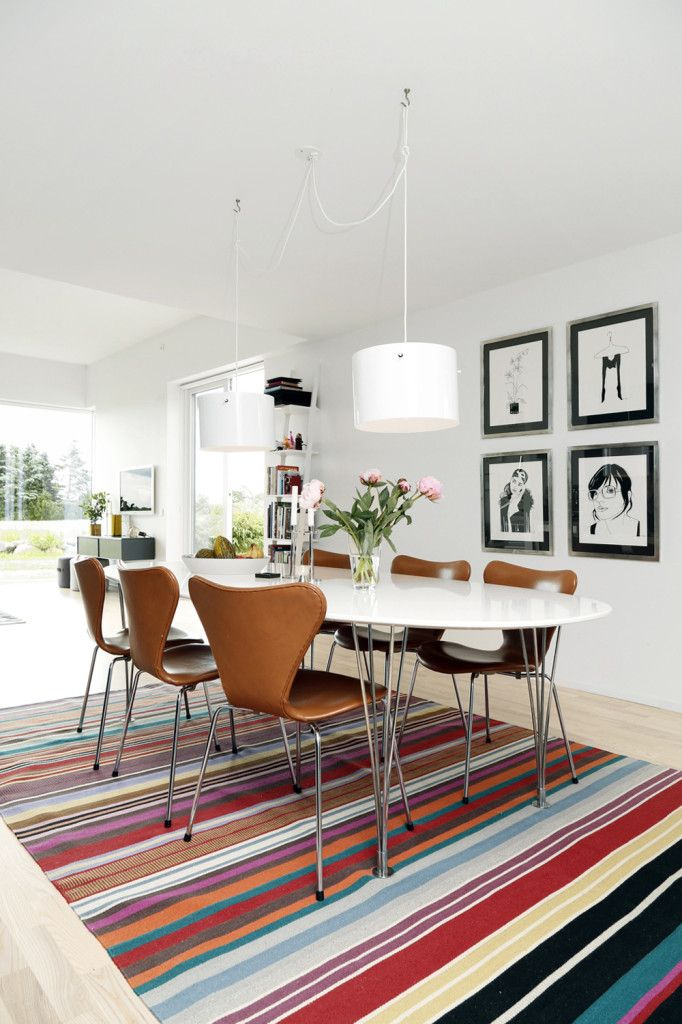 Dining area with retro influence l White drum pendant light l Colourful stripe rug l Dining Room Inspiration l 10 Stylish Dining Rooms