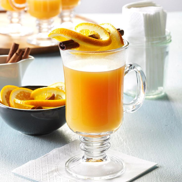 Hot Cider with Orange Twists Recipe -I first tasted a steaming mug of this comforting beverage on a frigid evening. It's still a family favorite on a wintry day. —Catherine Allan, Twin Falls, Idaho