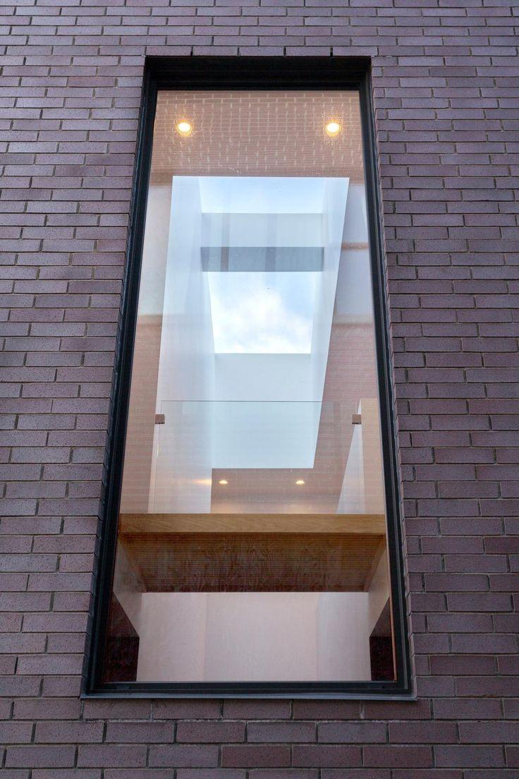 Thin Natural Steel Window Surround At Brick Exterior