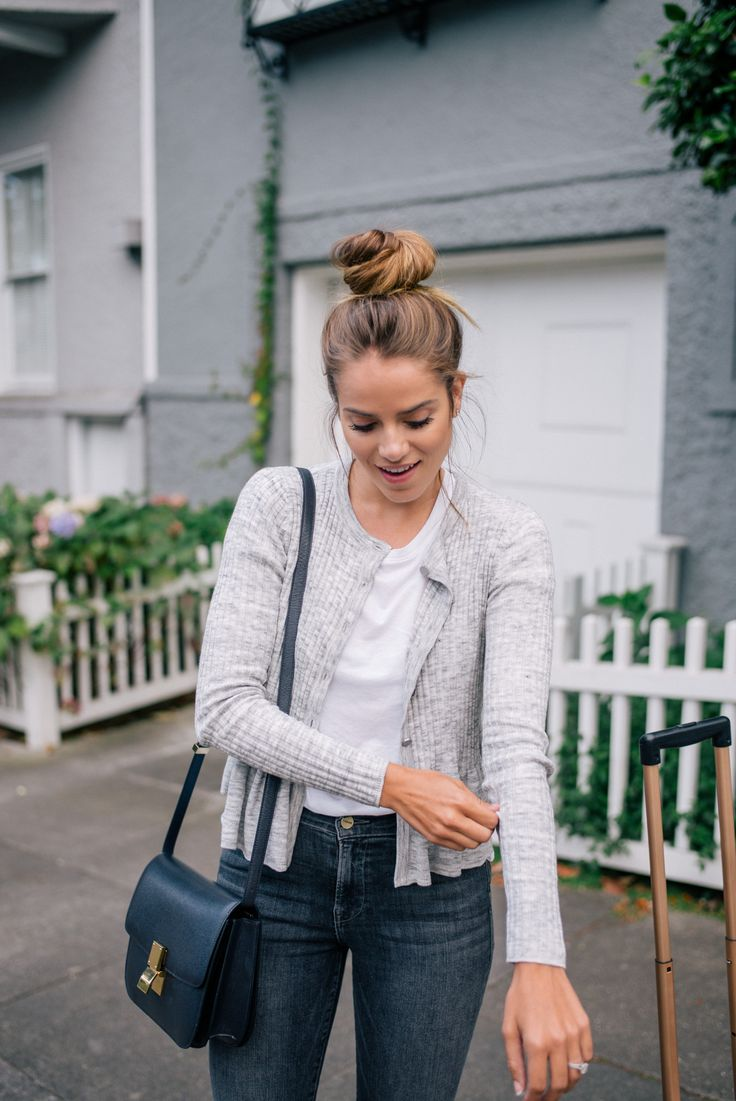 Gal Meets Glam Easy Travel Style - Rebecca Taylor sweater, The Lady & The Sailor tee, Frame Denim jeans, and Celine bag