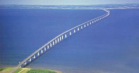 """The Confederation Bridge (French: Pont de la Confédération) is a bridge spanning the Abegweit Passage of #Northumberland Strait, linking Prince Edward Island with mainland New Brunswick, #Canada. It was commonly referred to as the """"Fixed Link"""" by residents of Prince Edward Island prior to its official naming. Construction took place from the fall of 1993 to the spring of 1997, costing $1.3 billion. The 12.9-kilometre (8 mi) long bridge opened on 31 May 1997."""