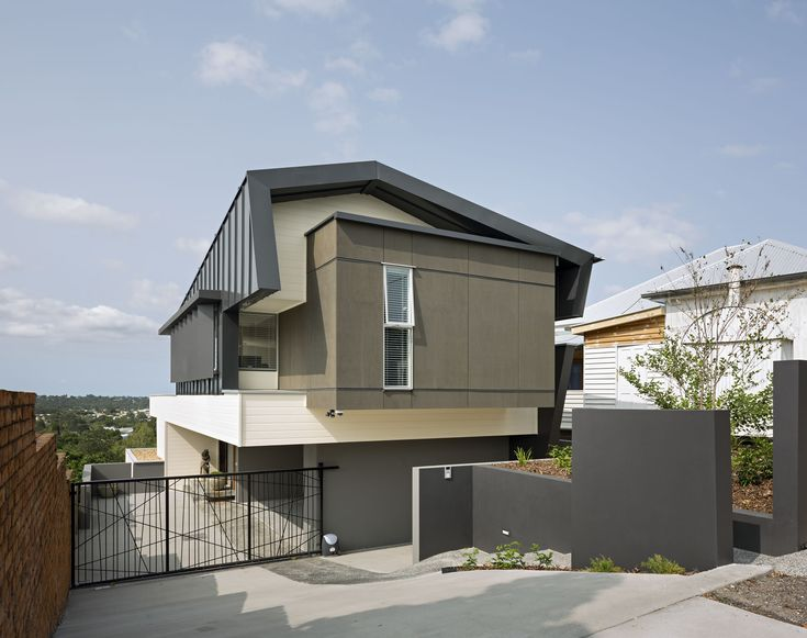 This Home Is Rich Is Architectural Detail, And The Sloping Drive Leads Down  Into The Ground Level Of The Home. The Front Has Fewer Windows To Preserve  ...