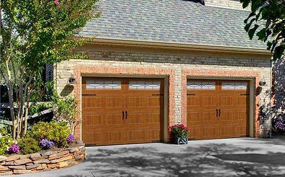 Faux wood steel garage door choose your garage doors for Faux finish garage doors