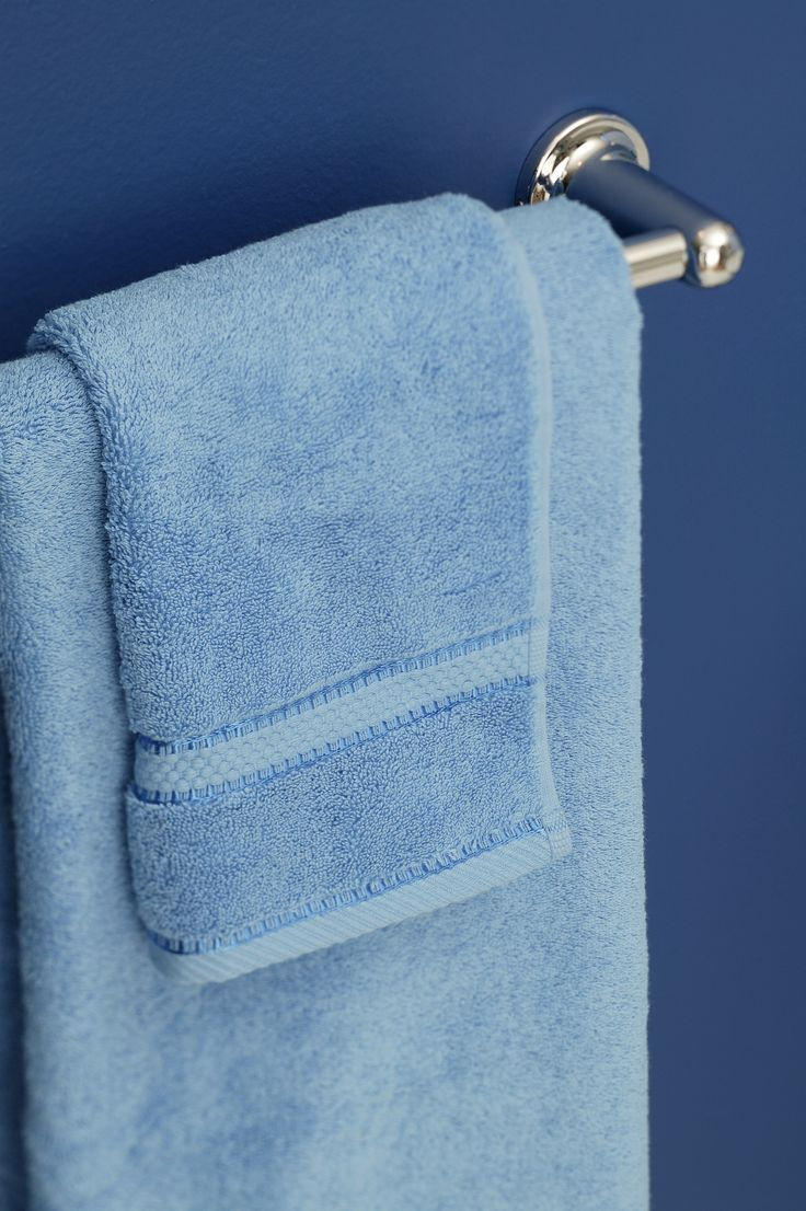 To keep towels from getting musty in between showers, hang them where they can air-dry thoroughly. A hook is fine, but a towel bar is better.   - HouseBeautiful.com