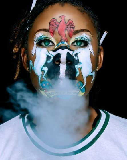 Corper Paints Coat Of Arms On Her Face ToCelebrate Nigeria At 57 (Photos)