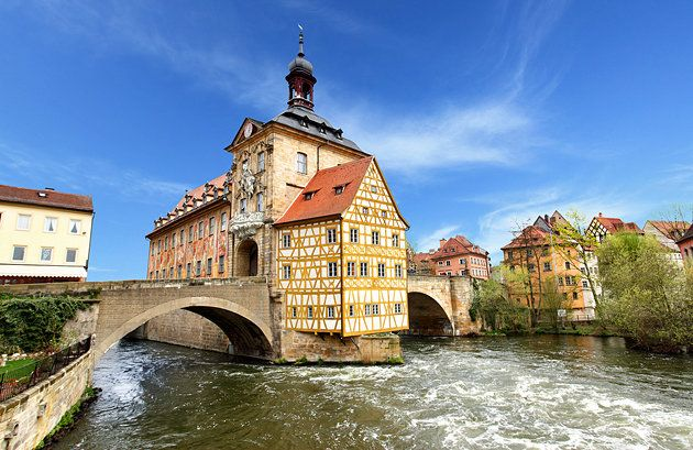 Bamberg's Old Town at Obere Brücke, the Upper Bridge. Old Town Hall (Altes Rathaus) in the middle of the bridge. While a town hall had been located here as far back as 1386, the existing structure was rebuilt between 1744-56. Bamberg is the most important community in Upper Franconia in Bavaria. The oldest part is the episcopal town on the high west bank of the left arm of the river, with the cathedral and the old Benedictine abbey of Michaelsberg.