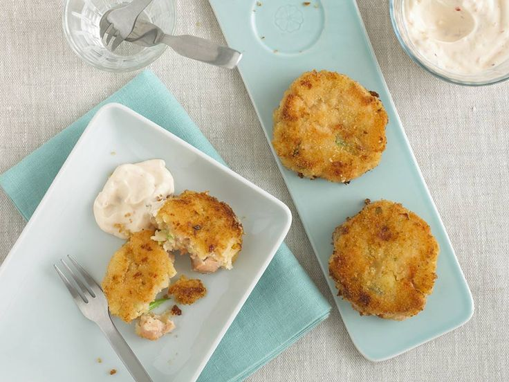 Salmon fishcakes are a classic for a good reason; they're easy to make, satisfying to eat and taste delicious. I make these for a light weekend lunch or a quick and tasty weekday supper. Children will love dunking these yummy fishcakes into the sweet chilli dip.