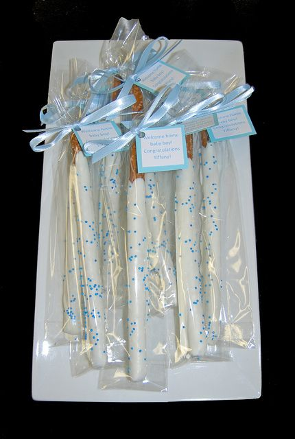 white chocolate dipped pretzel rods with blue sprinkles for First Communion
