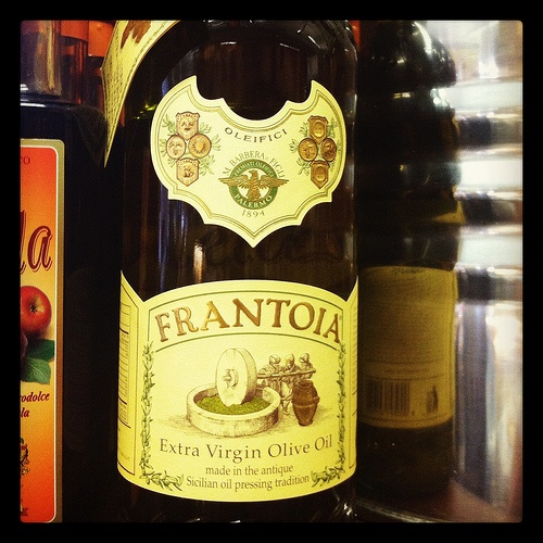 Frantoia Extra Virgin Olive Oil.  This is a staple item in the D'Angelo Pantry because, not only are we partial to Sicilian products, but also you can really taste the olives!  A dollop of this special product can transform a bowl of lentil soup from chow to wow, and makes your own fagiolini salad feel like you've ordered it from chef Mario Batali---and it's good for your hair and skin to boot!  Taste & feel for yourself.