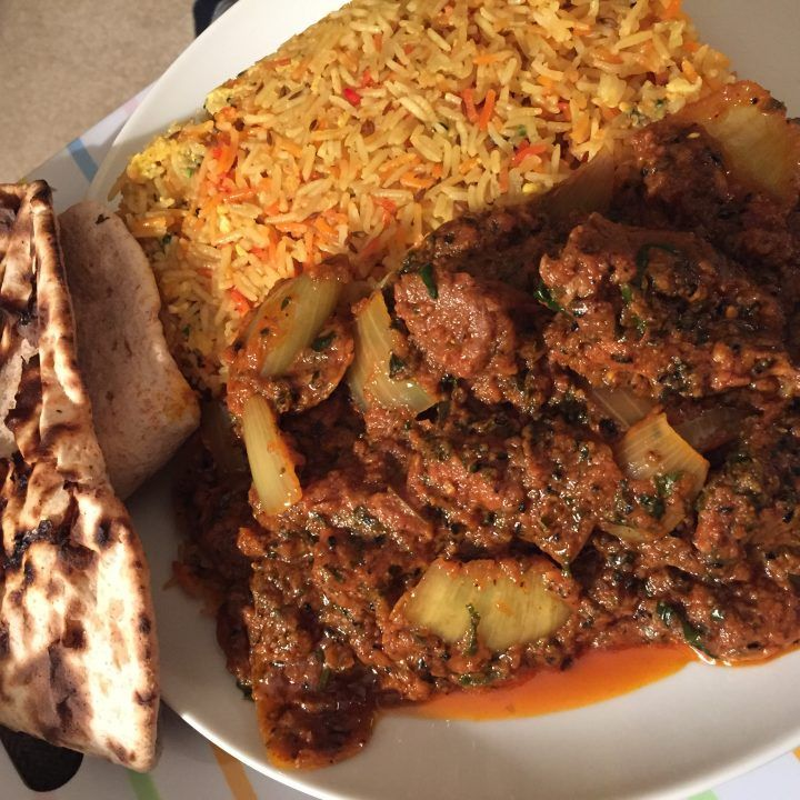Asian style lamb dopiaza with egg pilau rice and roti.
