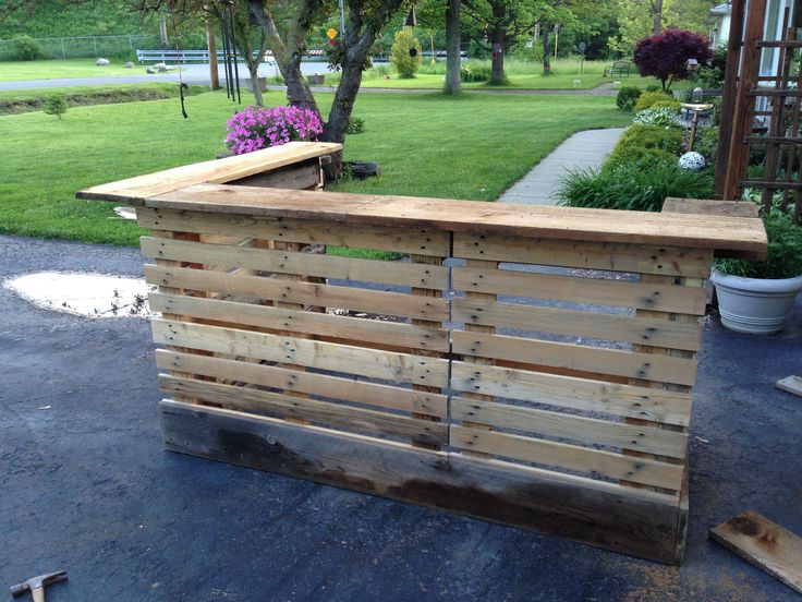 Bar made from upcycled pallets and 200 year old barn wood. Please see other pics of finished bar! It looks much better!