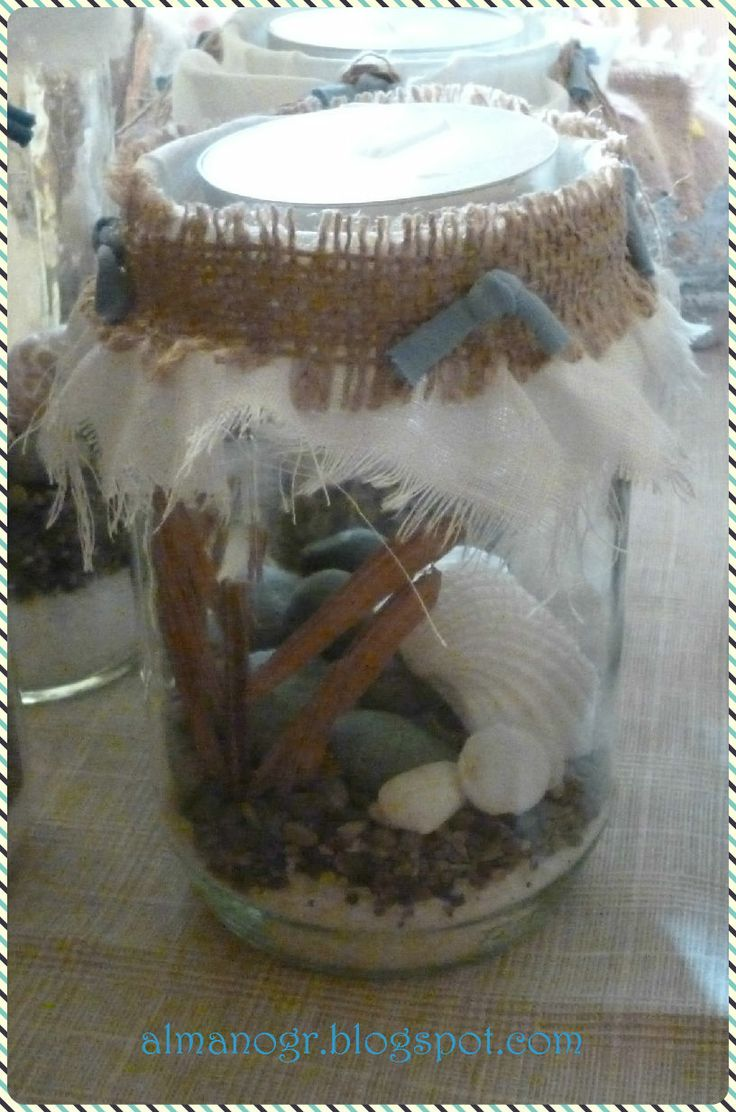Jar with driftwood, sponge, shells, salt, pebbles and stones. It closed with linen and burlap to protect the content, creating a position for small or large tealights