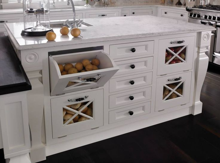 We love Wood-Mode's specialized cabinets and compartments. www.cabinetsanddesigns.net