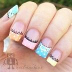 Adorable looking candy colored French tips. You can also add lace designs below the French tips in black nail polish. The white polka dots on the French tips also add to the cuteness factor of the design.