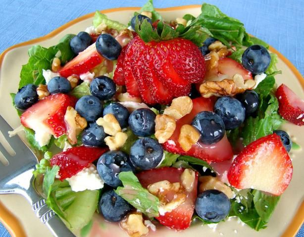 Beautiful! Mixed salad greens, strawberries, blueberries, feta cheese, raspberry vinegrette  dressing.