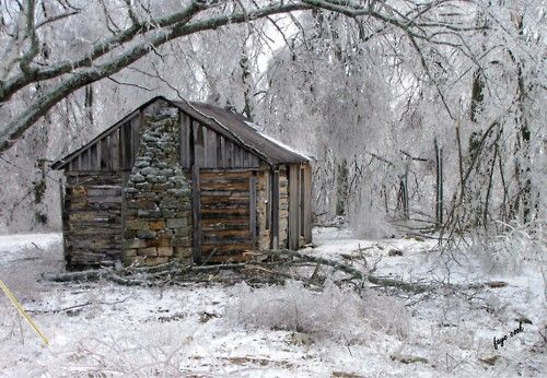The ice storm of January 2009 was a disaster for Kentucky, but also quite beautiful.    The photographer's husband was born in this cabin in 1950.    © Faye Cook