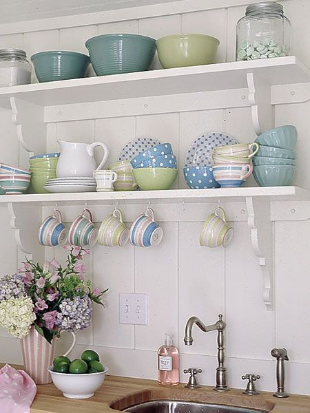 Fun dishes on open shelves.