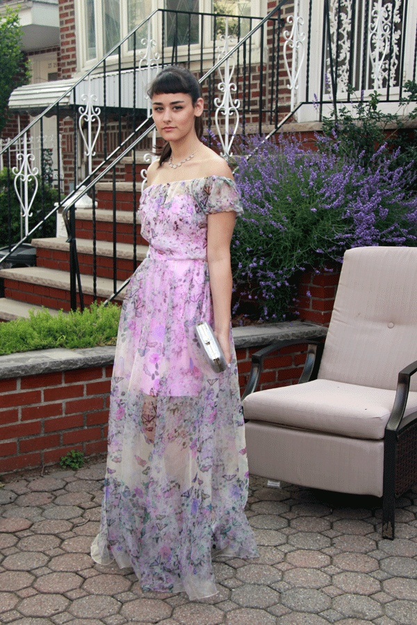 The dress is absolutely fantastic. It has a pinkish-purple satin slip underneath with a sweetheart neckline. On top is this a sheer chiffon fabric.