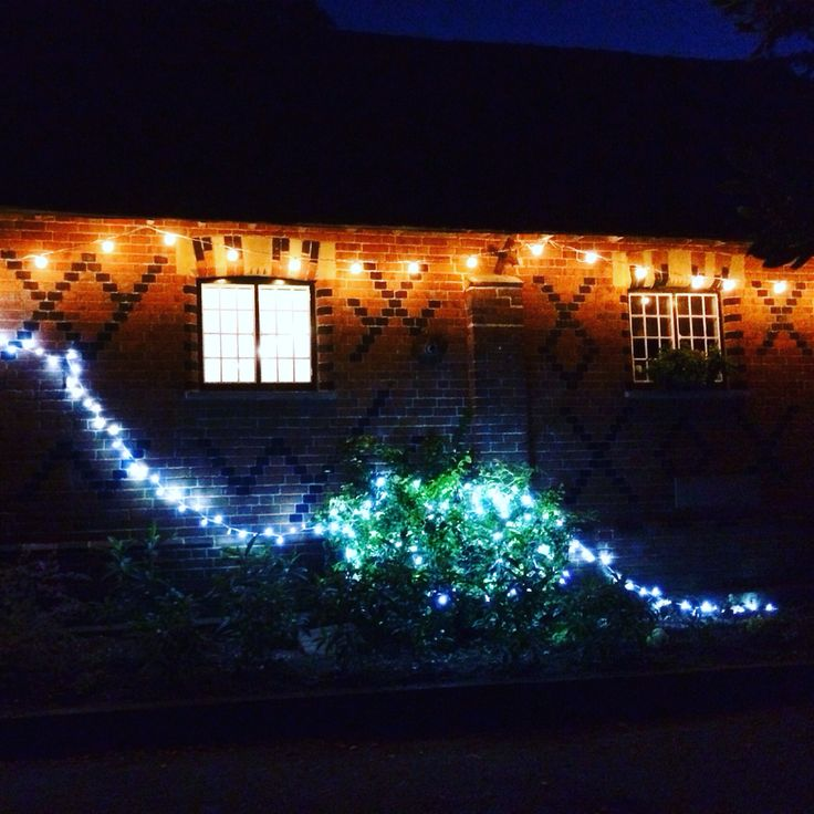 Festoon lighting in the courtyard at Dorney Court. Coach House Barn  http://www.lexmarqueehire.co.uk/dorney-court-wedding