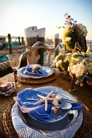 Beach wedding table setting, aren't they adorable?