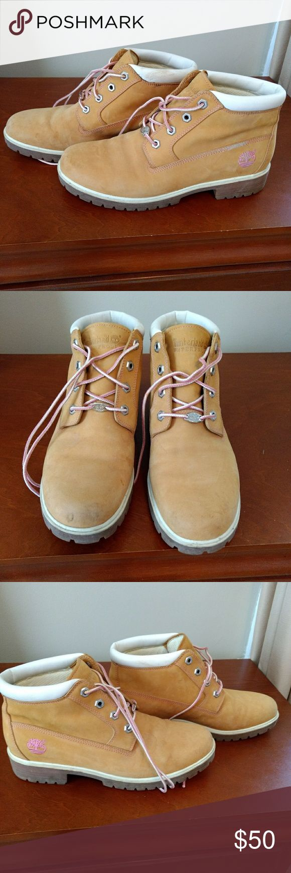Timberland women's hiking boots size 10 These are a pair of Timberland women's hiking boots with pink accents on the side and pink and white laces. These are very cute! I bought them for a trip to the South thinking that I would need to wear Timberlands! I only wore them once or twice but not for any kind of outdoor things. I haven't had occasion to wear them so they have been sitting on my shoe tree. There's a lot of wear left in these. A good cleaning will make them good as new. The pink…